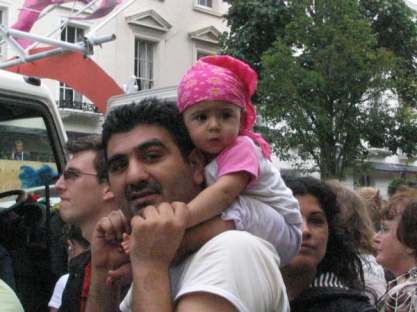 A father and child enjoying a parade