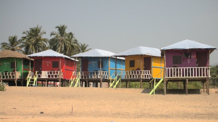 Colorful beach huts on the beach in Goa